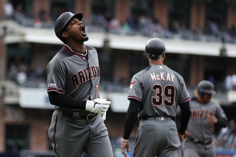 Arizona Diamondbacks' Adam Jones, left, reacts after flying out during the ninth inning of the team's baseball game against the San Diego Padres, Wednesday, May 22, 2019, in San Diego. (AP Photo/Gregory Bull)