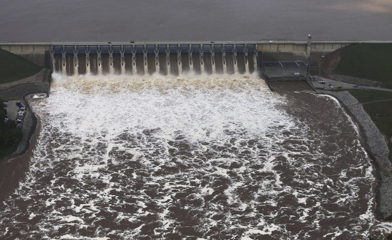 The Keystone dam on the Arkansas river on Wednesday, May 22, 2019. Authorities on Wednesday encouraged people living along the Arkansas River in the Tulsa suburb of Bixby and low-lying areas near creeks both north and south of Okmulgee, about 35 miles (56 kilometers) south of Tulsa. to leave their homes. (Tom Gilbert/Tulsa World via AP)