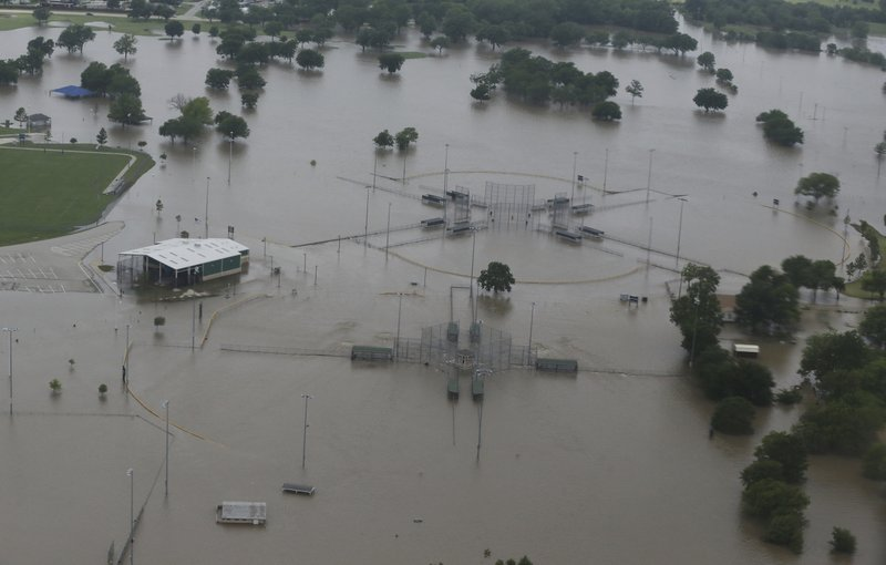 O'Brien Park on North Lewis Ave during flooding on Bird Creek in Tulsa, Okla., on Wednesday, May 22, 2019. Authorities on Wednesday encouraged people living along the Arkansas River in the Tulsa suburb of Bixby and low-lying areas near creeks both north and south of Okmulgee, about 35 miles (56 kilometers) south of Tulsa. to leave their homes. (Tom Gilbert/Tulsa World via AP)