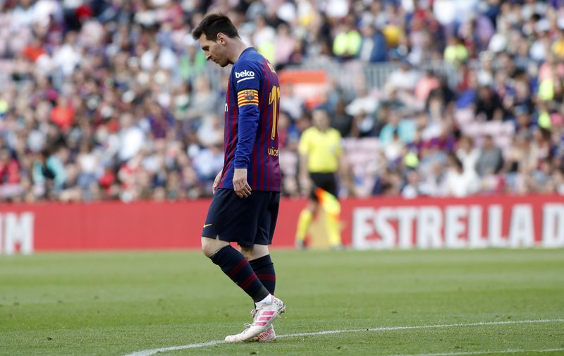 Barcelona forward Lionel Messi walks during the Spanish La Liga soccer match between FC Barcelona and Getafe at the Camp Nou stadium in Barcelona, Spain, Sunday, May 12, 2019. (AP Photo)