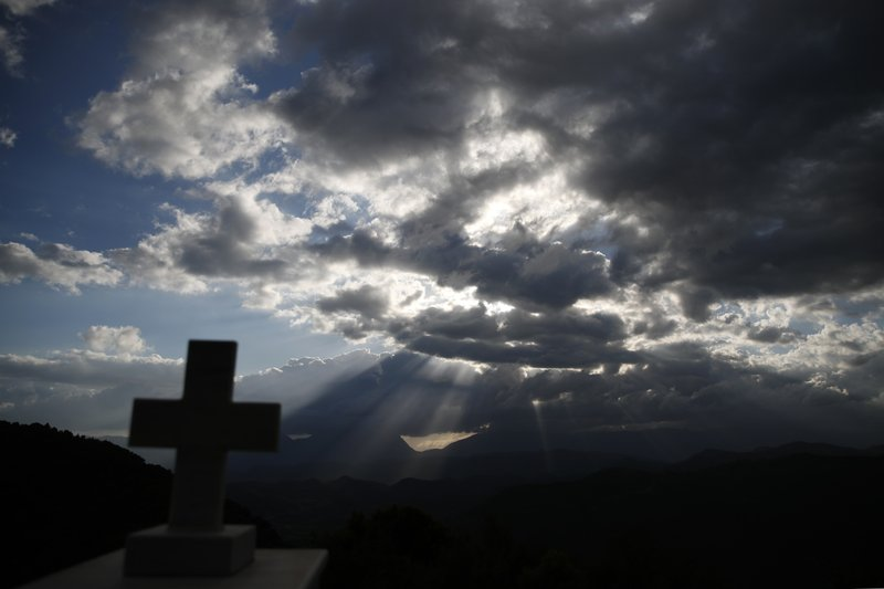In this Tuesday, May 14, 2019, photo the sun sets over the mountains of Evrytania region, in central Greece. The area, a winding, three-hour drive from Athens, has the oldest population in the whole European Union, 54.3 on average. (AP Photo/Thanassis Stavrakis)