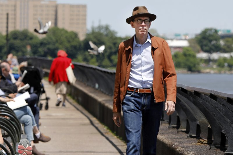 Kevin Kusinitz, a 63-year-old New Yorker who spent years being rejected from jobs for which he felt overqualified following an August 2012 layoff, walks near New York's East River, Wednesday, May 22, 2019. About half of Americans think there's age discrimination in the workplace, according to a new poll by The Associated Press-NORC Center for Public Affairs Research. (AP Photo/Richard Drew)