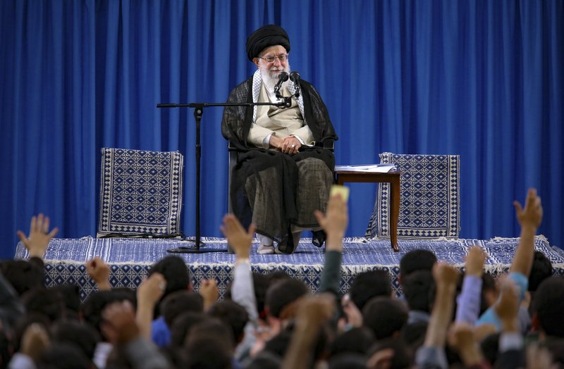 In this picture released on Wednesday, May 22, 2019, by an official website of the office of the Iranian supreme leader, Supreme Leader Ayatollah Ali Khamenei attends a meeting with a group of students as they chant slogans, in Tehran, Iran. Khamenei publicly chastised the country's moderate president and foreign minister Wednesday, saying he disagreed with the implementation of the 2015 nuclear deal they had negotiated with world powers. (Office of the Iranian Supreme Leader via AP)