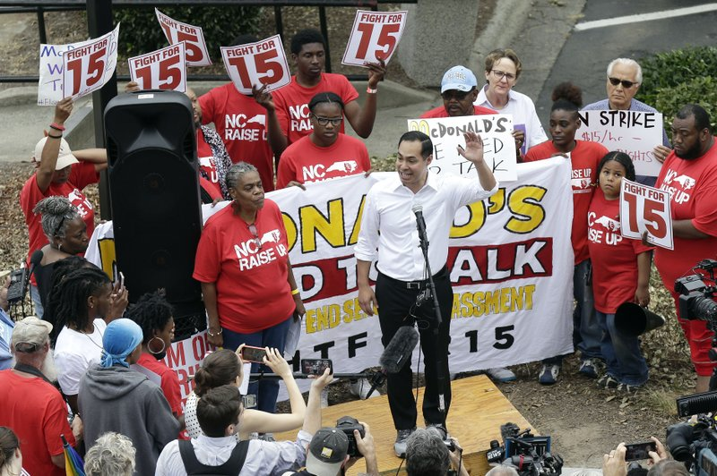 Presidential candidate and former U.S. Department of Housing and Urban Development Julian Castro rallies with McDonald's employees and other activists demanding fairer pay, better working conditions, and the right to unionize in Durham, N.C., Thursday, May 23, 2019. (AP Photo/Gerry Broome)