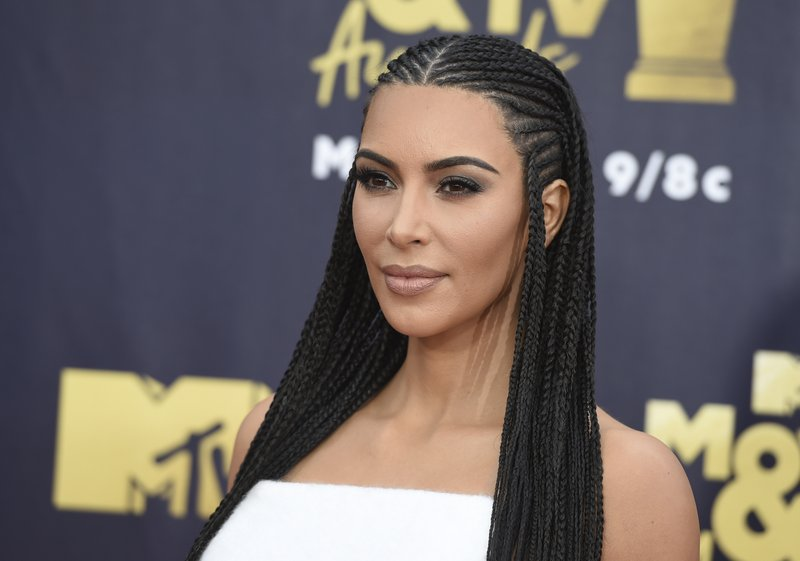 FILE - In this June 16, 2018 file photo, Kim Kardashian West arrives at the MTV Movie and TV Awards at the Barker Hangar in Santa Monica, Calif. Kardashian West isn't the only celebrity speaking out for prison reform. It's a topic that was also very important to slain rapper Nipsey Hussle, and to Common, Kevin Hart and a host of others who consider the criminal justice system often unfair and dehumanizing. (Photo by Jordan Strauss/Invision/AP, File)