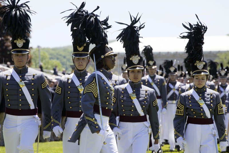 In this May 22, 2019 photo, cadet Isabella Minter, center, marches with senior class members during Parade Day at the U.S. Military Academy in West Point, N.Y. The jubilant crowd of cadets tossing their caps in air at the graduation ceremony Saturday, May 25,  will include a record-high 34 black women, a sign of concerted efforts to diversify the Long Gray Line. (AP Photo/Mark Lennihan)