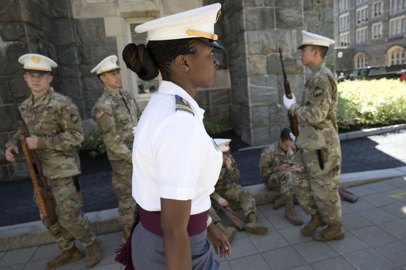 In this May 22, 2019 photo, senior cadet Stephanie Riley, of Jacksonville, Fla., walks across campus in West Point, N.Y. On Saturday, May 25, Riley will be among the graduates commissioned second lieutenants in the U.S. Army after an address by Vice President Mike Pence. She will go into the Signal Corps. (AP Photo/Mark Lennihan)