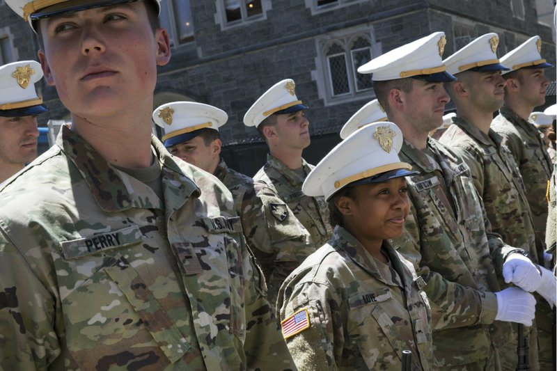 In this May 22, 2019 photo Briana Love, center, and fellow underclassmen prepare to drill at the U.S. Military Academy in West Point, N.Y. The class graduating on Saturday, May 25,  will include 223 women, the largest number since the first female cadets graduated in 1980. It will include 117 African-Americans, more than double the number from 2013, and the largest number of Hispanics, 88. (AP Photo/Mark Lennihan)
