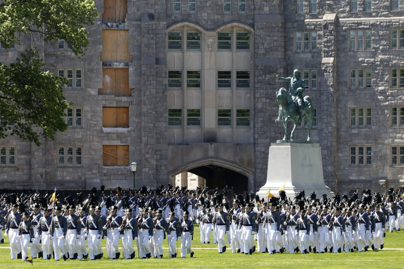 In this May 22, 2019 photo members of the senior class march past a statue of George Washington during Parade Day at the U.S. Military Academy in West Point, N.Y. West Point boosted efforts to recruit women and blacks after being told to diversify in 2013 by then-Army Chief of Staff Gen. Raymond Odierno. (AP Photo/Mark Lennihan)