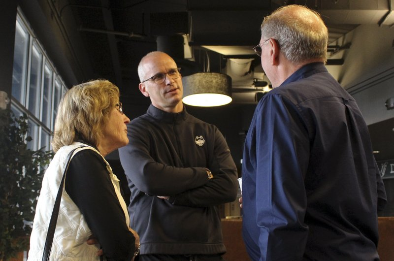 University of Connecticut NCAA college basketball coach Dan Hurley, center, chats with fans on Thursday, May 23, 2019, at Dunkin' Donuts Park in Hartford, Conn. Hurley and other UConn coaches are touring the state as part of the second annual Coaches Road Show to engage the school's fan base. (AP Photo/Pat Eaton-Robb)