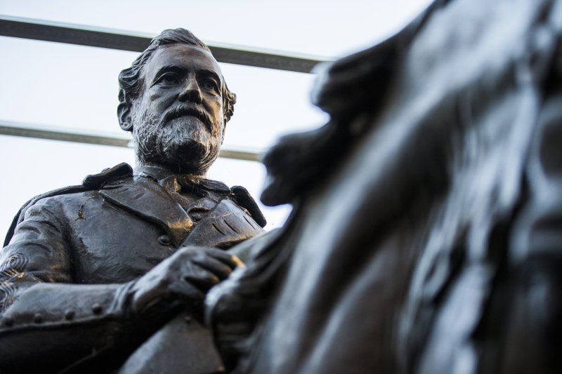FILE--In this Dec. 20, 2018, file photo the 1935 statue of Robert E. Lee, by sculptor Alexander Phimister, sits in storage at Hensley Field, the former Naval Air Station on the west side of Mountain Creek Lake in Dallas. Dallas City Council Wednesday, May 22, 2019 declared the statue surplus property and offered to sell it for a minimum $450,000, what it cost to move the bronze artwork from public view. The statue was removed from a park in September 2017 and put in storage and has been appraised at $950,000, which Dallas authorities say could pay for removal of the city's Confederate War Memorial.(Ashley Landis/The Dallas Morning News via AP, File)