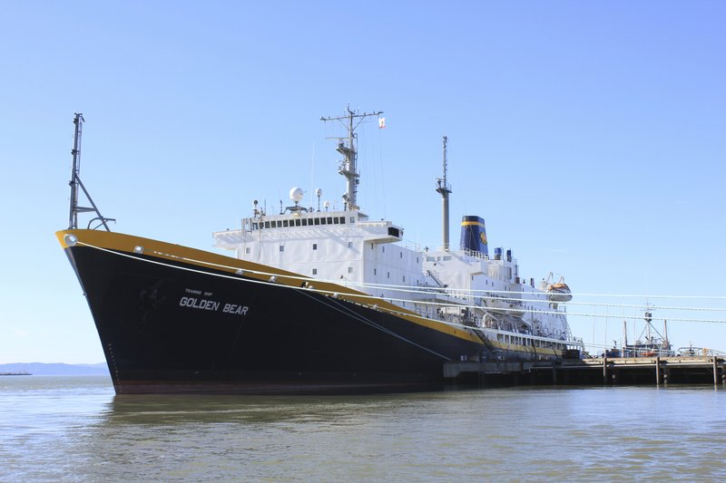In this 2014 photo provided by the California State University Maritime Academy shows the Golden Bear training ship docked at it's training facility in Vallejo, Calif. The California Maritime Academy's training ship is resuming a cruise after being damaged in the eastern Caribbean. The academy says the ship struck a shoreside gantry crane while arriving in Barbados this week under the control of a local pilot. The ship's main mast was damaged but no one was injured. (Robert King/California State University Maritime Academy via AP)