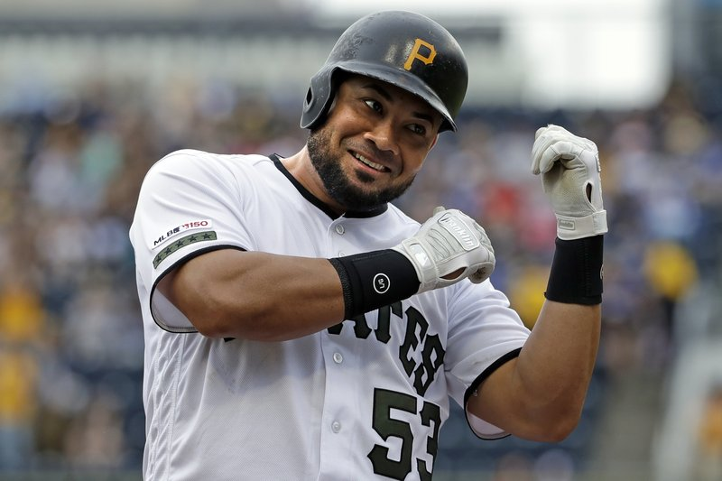 Pittsburgh Pirates' Melky Cabrera celebrates after driving in a run with a double off Colorado Rockies starting pitcher Antonio Senzatela during the first inning of a baseball game in Pittsburgh, Thursday, May 23, 2019. Cabrera advanced to third on the throw to the plate. (AP Photo/Gene J. Puskar)