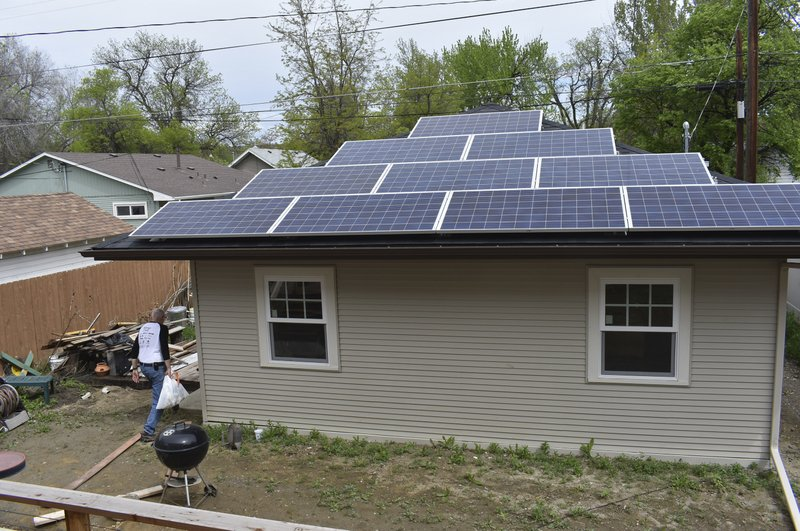 A garage with rooftop solar panels to generate electricity for a nearby house is seen in Billings, Mont. on Thursday, May 23, 2019. Over the past two decades, about 2,300 NorthWestern Energy customers in Montana have installed their own solar panels. (AP Photo/Matthew Brown)