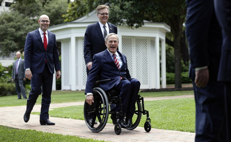 Gov. Greg Abbott, right, Lt. Governor Dan Patrick, center, and Speaker of the House Dennis Bonnen, left, arrive for a joint news conference to discuss teacher pay and school finance at the Texas Governor's Mansion in Austin, Texas, Thursday, May 23, 2019, in Austin. (AP Photo/Eric Gay)