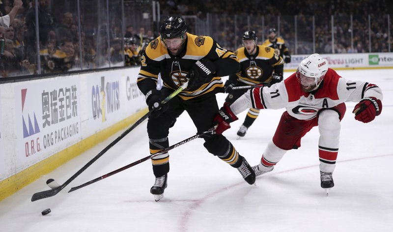 Carolina Hurricanes' Jordan Staal (11) tries to poke the puck away from Boston Bruins' David Backes, left, during the second period in Game 1 of the NHL hockey Stanley Cup Eastern Conference finals, Thursday, May 9, 2019, in Boston. (AP Photo/Charles Krupa)