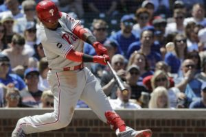 Segura helps Phillies beat Lester, Cubs 9-7