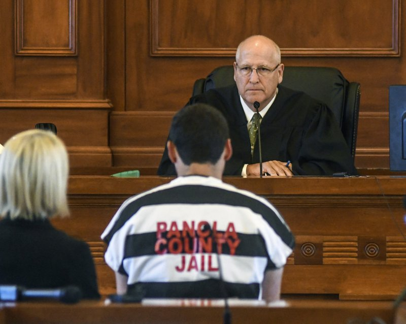Judge Andrew K. Howorth speaks to Oxford, Miss. police officer Matt Kinne, right, and his attorney Tiffany Kilpatrick during a hearing at the Lafayette County Courthouse in Oxford, Miss., Wednesday, May 22, 2019. Relatives of Dominque Clayton, a slaying victim were outraged Wednesday when Mississippi court officials discussed possible bail for a white police officer accused of killing the black woman with whom he was romantically involved. (Bruce Newman/The Oxford Eagle via AP)