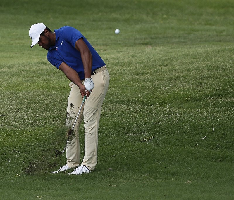 Tony Finau hits from the rough on the 18th hole  during the first round of the Charles Schwab Challenge golf tournament at Colonial Country Club in Fort Worth, Texas, Thursday, May 23, 2019. (Bob Booth/Star-Telegram via AP)