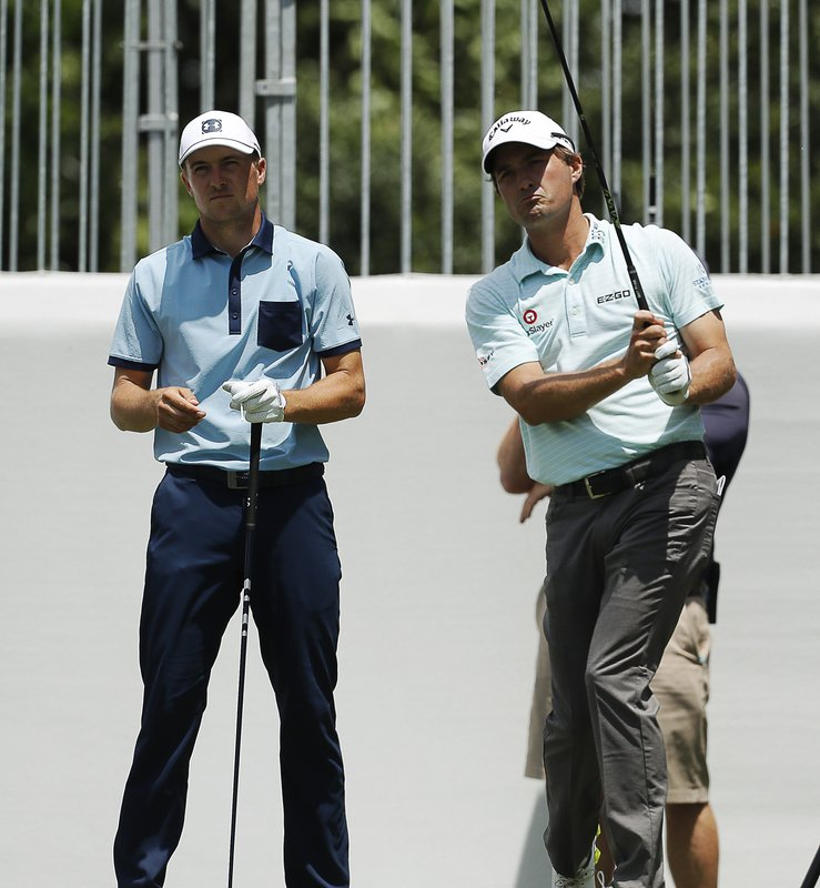 Jordan Spieth, left, watches Kevin Kisner's shot off the ninth tee during the first round of the Charles Schwab Challenge golf tournament at Colonial Country Club in Fort Worth, Texas, Thursday, May 23, 2019. (Bob Booth/Star-Telegram via AP)