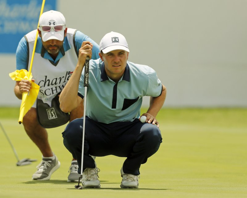Jordan Spieth and his caddie Mike Greller look over a putt on the ninth green during the first round of the Charles Schwab Challenge golf tournament at Colonial Country Club in Fort Worth, Texas, Thursday, May 23, 2019. (Bob Booth/Star-Telegram via AP)