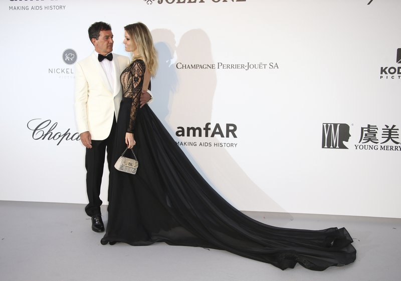 Actor Antonio Banderas and Nicole Kimpel pose for photographers upon arrival at the amfAR, Cinema Against AIDS, benefit at the Hotel du Cap-Eden-Roc, during the 72nd international Cannes film festival, in Cap d'Antibes, southern France, Thursday, May 23, 2019. (Photo by Joel C Ryan/Invision/AP)