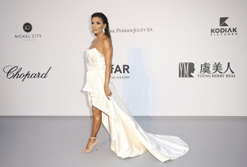 Actress Eva Longoria poses for photographers upon arrival at the amfAR, Cinema Against AIDS, benefit at the Hotel du Cap-Eden-Roc, during the 72nd international Cannes film festival, in Cap d'Antibes, southern France, Thursday, May 23, 2019. (Photo by Joel C Ryan/Invision/AP)