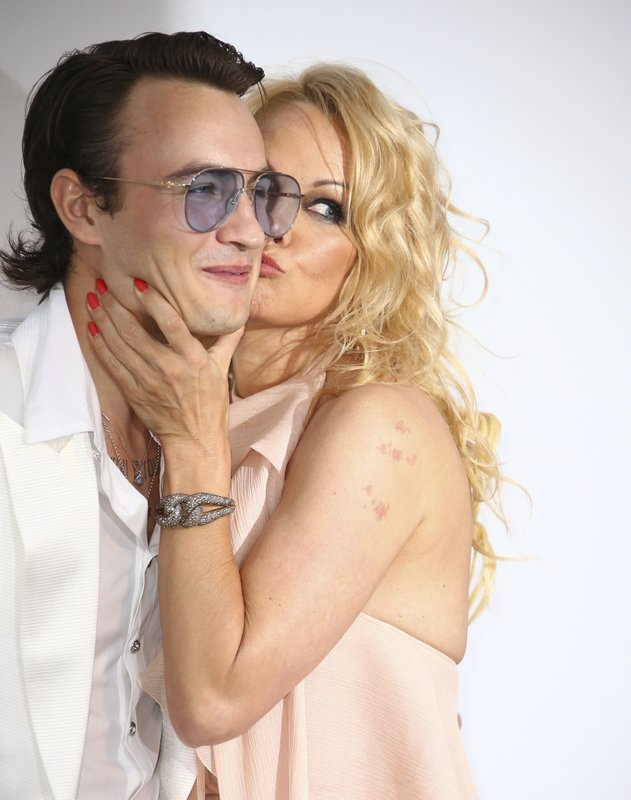 Actress Pamela Anderson, right, kisses her son Brandon Thomas Lee as they pose for photographers upon arrival at the amfAR, Cinema Against AIDS, benefit at the Hotel du Cap-Eden-Roc, during the 72nd international Cannes film festival, in Cap d'Antibes, southern France, Thursday, May 23, 2019. (Photo by Joel C Ryan/Invision/AP)