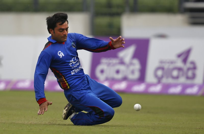 FILE - In this Wednesday Sept. 28, 2016 file photo, Afghanistan's Rashid Khan dives to stop the ball as he fields against Bangladesh during the second one-day international cricket match in Dhaka, Bangladesh. The 2019 Cricket World Cup starts in England on May 31. (AP Photo/A.M. Ahad, File)