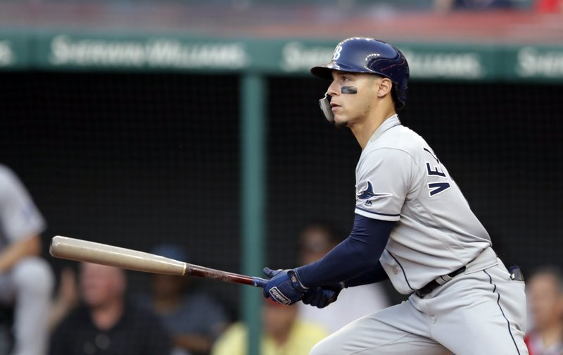 Tampa Bay Rays' Andrew Velazquez watches his double during the sixth inning of the team's baseball against the Cleveland Indians, Thursday, May 23, 2019, in Cleveland. (AP Photo/Tony Dejak)