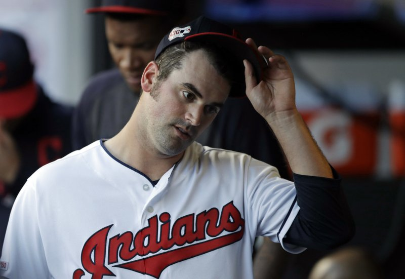 Cleveland Indians starting pitcher Adam Plutko takes off his cap in the sixth inning of the team's baseball game against the Tampa Bay Rays, Thursday, May 23, 2019, in Cleveland. Plutko pitched 5 1/3 innings and gave up 12 hits and seven runs. (AP Photo/Tony Dejak)