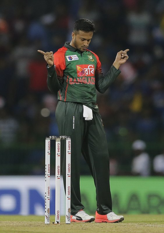 FILE - In this Friday, March 16, 2018 file photo, Bangladesh's Shakib Al Hasan celebrates the dismissal of Sri Lanka's Danushka Gunathilaka during their second T20 cricket match in Nidahas triangular series in Colombo, Sri Lanka. The 2019 Cricket World Cup starts in England on May 31. (AP Photo/Eranga Jayawardena, File)