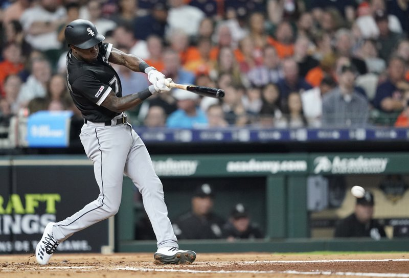 Chicago White Sox's Tim Anderson hits an RBI single against the Houston Astros during the third inning of a baseball game Thursday, May 23, 2019, in Houston. (AP Photo/David J. Phillip)