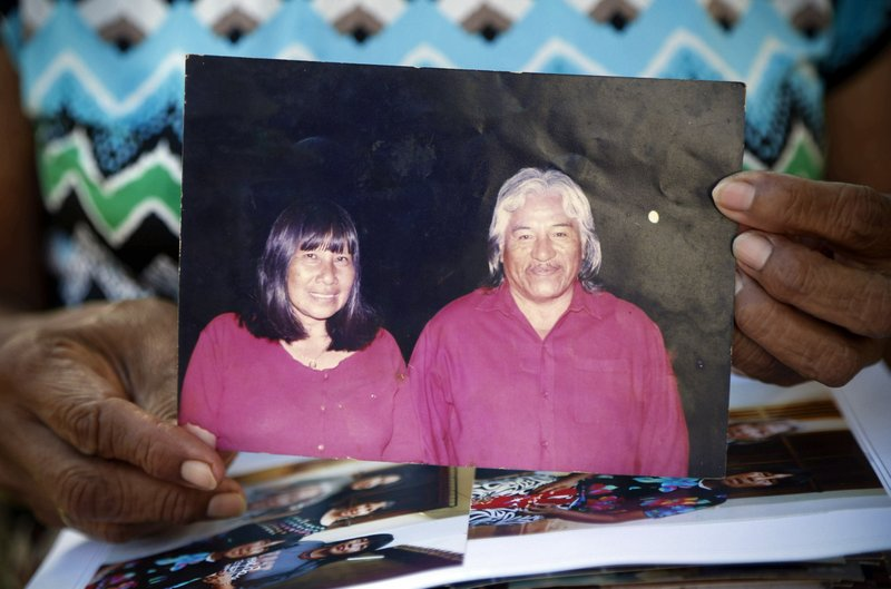 Maka indigenous leader-in-training Tsiweyenki, or Gloria Elizeche in Spanish, holds an undated portrait of herself with her husband Andres Chemei in Mariano Roque Alonso, Paraguay, Monday, April 29, 2019. After Chemei, a widely respected figure who led the Maka for 40 years, died in February without an heir, Maka leaders chose his widow to be one of the first female chiefs of an indigenous people in the South American country. (AP Photo/Jorge Saenz)