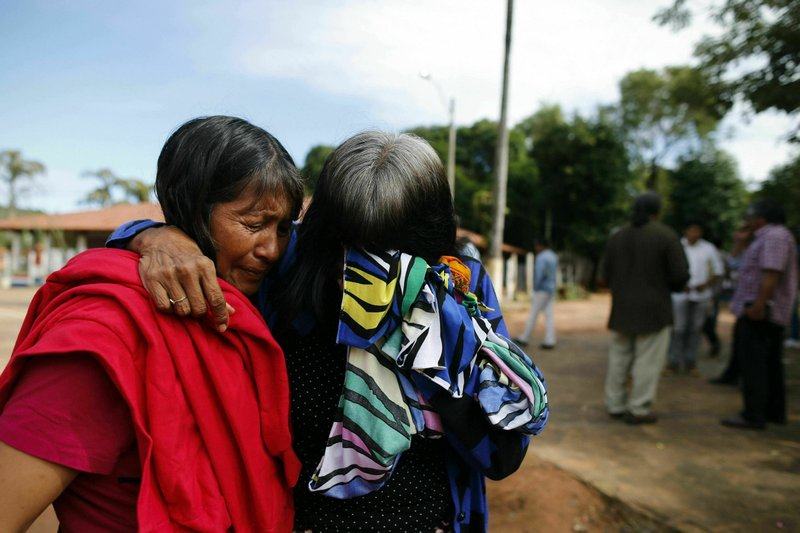Maka indigenous leader-in-training Tsiweyenki, or Gloria Elizeche in Spanish, right, is comforted by her friend Isabel as she mourns her late husband, former Maka leader Andres Chemei, in Mariano Roque Alonso, Paraguay, Sunday, April 5, 2019. While she still breaks down in tears at times thinking of her late husband, Tsiweyenki expressed thankfulness at her new post as chief of her ethnic group.