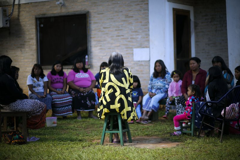 Maka indigenous leader-in-training Tsiweyenki, or Gloria Elizeche in Spanish, leads a women's meeting in Mariano Roque Alonso, Paraguay, Tuesday, May 14, 2019. The 68-year-old Tsiweyenki, has a warm smile, but the difficult task of carrying on her late husband's battle to assert ownership of lands where the Maka lived for four decades. (AP Photo/Jorge Saenz)