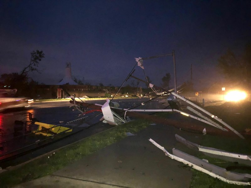 Downed power lines stretch into a street in tornado-hit Jefferson City, MO., Thursday, May 23, 2019. The National Weather Service has confirmed a large and destructive tornado has touched down in Missouri's state capital, causing heavy damage and trapping multiple people in the wreckage of their homes. (AP Photo/David A. Lieb)