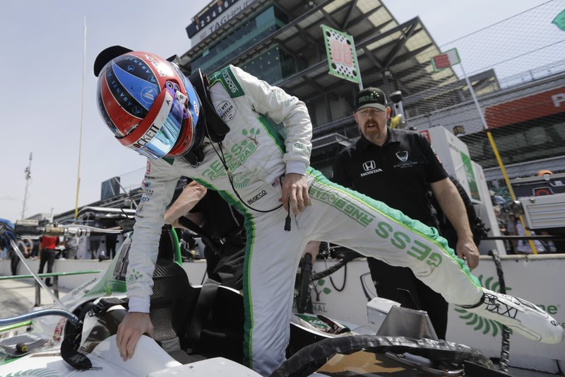 Colton Herta climbs into his car during practice for the Indianapolis 500 IndyCar auto race at Indianapolis Motor Speedway, Thursday, May 16, 2019 in Indianapolis. (AP Photo/Darron Cummings)
