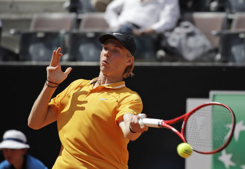 FILE - In this Thursday, May, 16, 2019 file photo, Canada's Denis Shapovalov returns the ball to Serbia's Novak Djokovic at the Italian Open tennis tournament, in Rome. It's typically Canadian that Denis Shapovalov, Felix Auger-Aliassime and Bianca Andreescu are each children of immigrants. What's not typical is that they have all simultaneously broken into the world's elite ranks of tennis players _ and will all be worth watching when the French Open begins Sunday. (AP Photo/Alessandra Tarantino, File)