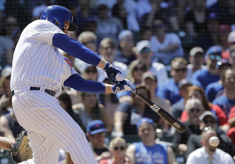 Chicago Cubs' Anthony Rizzo hits a two-run single during the fourth inning of a baseball game against the Philadelphia Phillies, Thursday, May 23, 2019, in Chicago. (AP Photo/Nam Y. Huh)