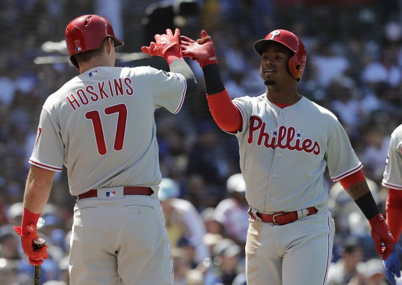 Philadelphia Phillies' Jean Segura, right, celebrates with Rhys Hoskins after hitting a two-run home run against the Chicago Cubs during the fourth inning of a baseball game Thursday, May 23, 2019, in Chicago. (AP Photo/Nam Y. Huh)