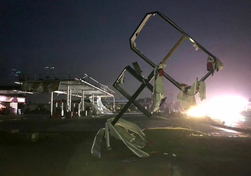 A destroyed sign for a car wash is seen in tornado-hit Jefferson City, MO., Thursday, May 23, 2019. The heavily damaged gas station is at background. The National Weather Service has confirmed a large and destructive tornado has touched down in Missouri's state capital, causing heavy damage and trapping multiple people in the wreckage of their homes. (AP Photo/David A. Lieb)