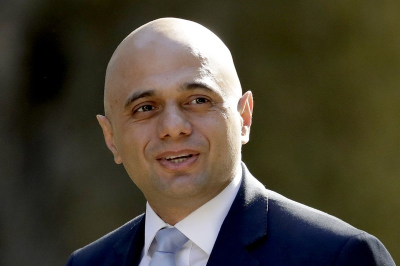 FILE - In this Tuesday, May 1 , 2018 file photo, Britain's newly appointed Home Secretary Sajid Javid arrives for a cabinet meeting at 10 Downing Street in London. Prime Minister Theresa May's announcement that she will leave 10 Downing Street has set off a fierce competition to succeed her as Conservative Party leader _ and as the next prime minister.  (AP Photo/Matt Dunham, File)