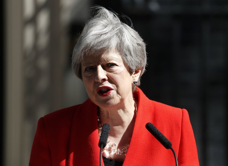 British Prime Minister Theresa May makes a speech in the street outside 10 Downing Street in London, England, Friday, May 24, 2019. Theresa May says she'll quit as UK Conservative leader on June 7, sparking contest for Britain's next prime minister. (AP Photo/Alastair Grant)