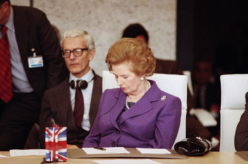 FILE - In this Thursday, Nov. 20, 1990 file photo, British Prime Minister Margaret Thatcher dozes off for a few minutes while attending the Conference on Security and Cooperation in Europe. A few days later, Thatcher resigned after 11 years as prime minister, largely because of her strident views on future European integration.  On Friday, May 24, 2019 announced she would resign as party leader, effective June 7, because of her inability to deliver on a referendum to leave the European Union. May has joined the ranks of Conservative prime ministers whose time in office has been overwhelmed — and cut short — by the issue of Europe. (AP Photo/Lionel Cironneau, File)
