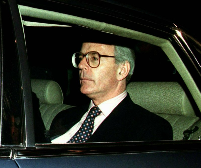 FILE - In this Friday May 2, 1997 file photo, British Prime Minister John Major drives away after retaining his parliamentary seat in the general election that his Conservative Party lost.  On Friday, May 24, 2019 announced she would resign as party leader, effective June 7, because of her inability to deliver on a referendum to leave the European Union. May has joined the ranks of Conservative prime ministers whose time in office has been overwhelmed — and cut short — by the issue of Europe. (AP Photo/Lynne Sladky, File)