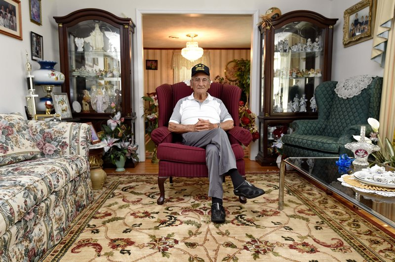 Dennis Trudeau, a World War II veteran who landed in Normandy on D-Day, poses for a photo at his home May, 21, 2019, in Grovetown, Ga. Trudeau had joined the Canadian military at 17 and became a paratrooper in part because they paid an extra $50 a month. (AP Photo/Richard Shiro)
