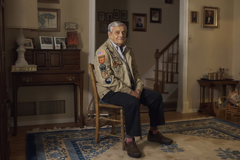 World War II U.S. veteran Frank DeVita, who took part in the D-Day battle poses for a picture at his home in Bridgewater, N.J., May 14, 2019. This June he'll make his 12th trip back to Normandy. He likes to bring people with him so they'll know what happened there. (AP Photo/Andres Kudacki)