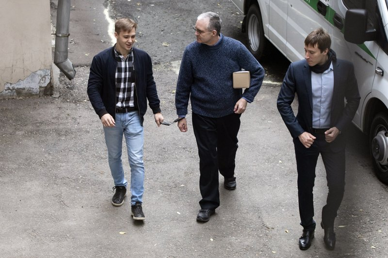 Paul Whelan, a former U.S. Marine, who was arrested in Moscow at the end of last year, is escorted for a hearing in a court in Moscow, Russia, Friday, May 24, 2019. The American was detained at the end of December for alleged spying. (AP Photo/Pavel Golovkin)