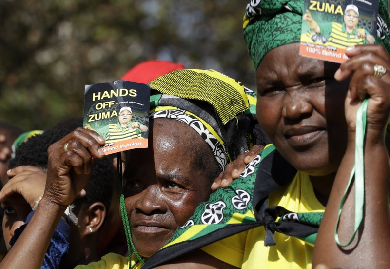 Supporters of the former South African President Jacob Zuma wait for him to address them outside the High Court in Pietermaritzburg, South Africa, Friday May 24, 2019. Zuma is in court facing charges of corruption, money laundering and racketeering. (AP Photo/Themba Hadebe)